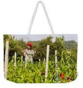 Young Woman Harvesting Red Peppers Weekender Tote Bag