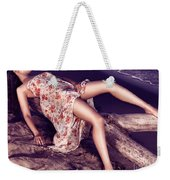 Young Woman In Dress Lying On Driftwood On A Shore Weekender Tote Bag