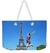 Young Woman Jumping Against Eiffel Tower Weekender Tote Bag