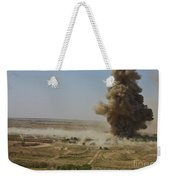 A Cloud Of Dust And Debris Rises Weekender Tote Bag