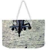 A Search And Rescue Swimmer Is Hoisted Weekender Tote Bag