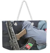 An Ak-47 Rests On The Sling Of An Weekender Tote Bag