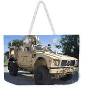 An Oshkosh M-atv Mine Resistant Ambush Weekender Tote Bag