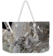 Astronaut Participates In A Session Weekender Tote Bag