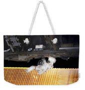 Astronaut Participates In A Spacewalk Weekender Tote Bag