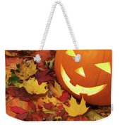Carved Pumpkin On Fallen Leaves Weekender Tote Bag
