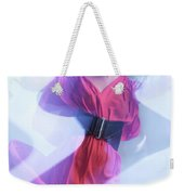 Fashion Photo Of A Woman In Shining Blue Settings Wearing A Red  Weekender Tote Bag