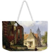 Figure Before A Redbrick Church In A Dutch Town Weekender Tote Bag