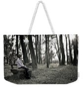 Girl Sitting On A Wooden Bench In The Forest Against The Light Weekender Tote Bag by Joana Kruse