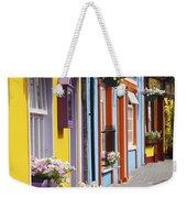Painted Buildings On Main Street In Weekender Tote Bag