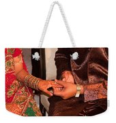 Putting The Gold And Diamond Engagement Ring On The Finger Of The Lady Weekender Tote Bag