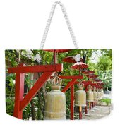 Row Of Bells In A Temple Covered By Red Umbrella Weekender Tote Bag
