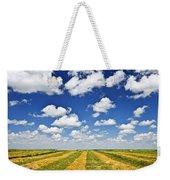 Wheat Farm Field At Harvest In Saskatchewan Weekender Tote Bag by Elena Elisseeva