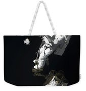 An Astronaut Anchored To A Mobile Foot Weekender Tote Bag