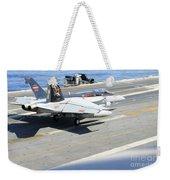 An Fa-18e Super Hornet Lands Aboard Weekender Tote Bag