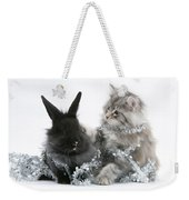 Kitten And Rabbit Getting Into Tinsel Weekender Tote Bag by Mark Taylor