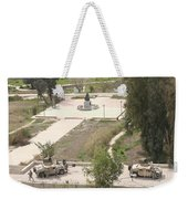 U.s. Military Soldiers Take A Well Weekender Tote Bag by Terry Moore
