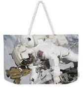 An Astronaut Participates In A Session Weekender Tote Bag