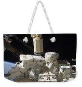 Astronauts Working On The International Weekender Tote Bag