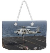 A Mh-60s Knighthawk Conducts A Vertical Weekender Tote Bag