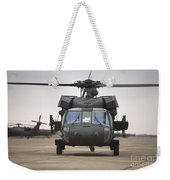A Uh-60 Black Hawk Taxis Weekender Tote Bag by Terry Moore
