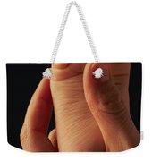 A Babys Foot In An Adult Hand Weekender Tote Bag