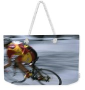 A Bicyclist Speeds Past In A Race Weekender Tote Bag