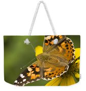 A Butterfly Sits Atop A Yellow Weekender Tote Bag