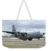 A C-130 Hercules Lands At Mcchord Air Weekender Tote Bag