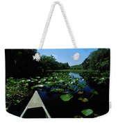 A Canoe Floats On A River Filled Weekender Tote Bag
