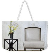 A Chair And A Table With A Plant  Weekender Tote Bag