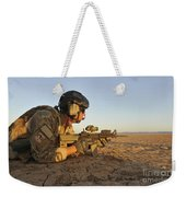 A Combat Rescue Officer Provides Weekender Tote Bag by Stocktrek Images