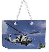 A Crew Chief Looks Out The Side Door Weekender Tote Bag by Michael Wood