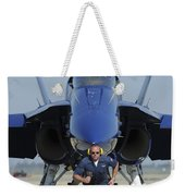 A Crew Chief Sprints Ahead Of A Blue Weekender Tote Bag
