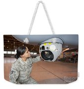 A Crew Chief Works On Mq-9 Reapers Weekender Tote Bag
