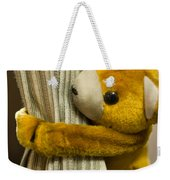 A Curtain With A Cute Stuffed Toy Weekender Tote Bag