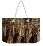 A Display Of Photographs And Uniforms Weekender Tote Bag