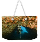 A Diver Explores A Cavern With Orange Weekender Tote Bag