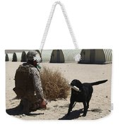A Dog Handler Calls Over A Black Weekender Tote Bag by Stocktrek Images