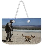 A Dog Handler Conducts Improvised Weekender Tote Bag by Stocktrek Images