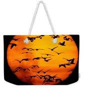 A Flock Of Geese Is Silhouetted Weekender Tote Bag