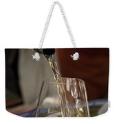 A Glass Of White Wine Being Poured Weekender Tote Bag