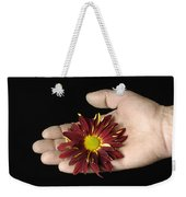 A Hand Holding A Red Rover Weekender Tote Bag