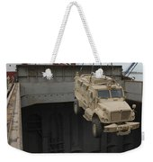 A Harbor Crane Lifts A Mine-resistant Weekender Tote Bag