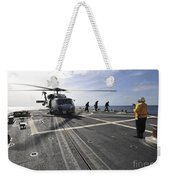 A Helicpter Sits On The Flight Deck Weekender Tote Bag
