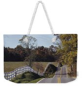 A Hilly Country Road Passes A Fenced Weekender Tote Bag