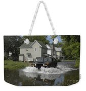 A Humvee Drives Through The Floodwaters Weekender Tote Bag