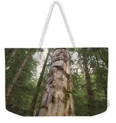 A Large Totem Pole Stands Amid Tall Weekender Tote Bag