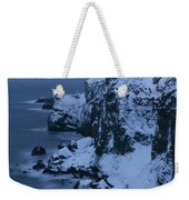 A Lighthouse Atop Snow-covered Cliffs Weekender Tote Bag