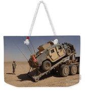 A M1114 Armored Vehicle Is Unloaded Weekender Tote Bag